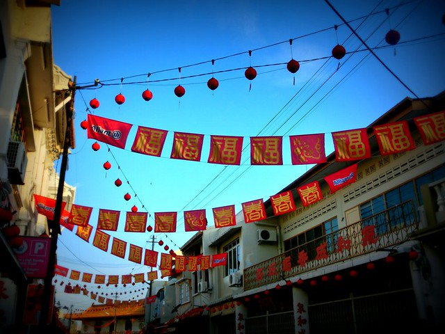 Red lanterns and flags on the streets of Melaka, Malaysia