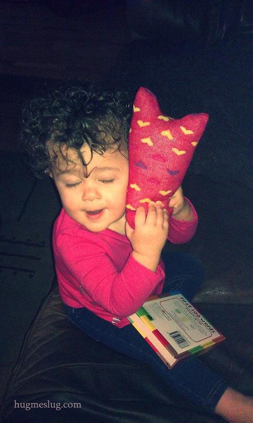 Baby girl hugging a sock kitten, Hug Me Kitten, original stuffed animal art toys by Elizabeth Ruffing