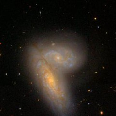 galaxies-merging-210350