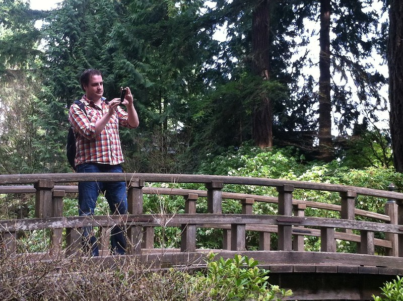 Dirkjan photographing from a bridge