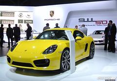 automobile(1.0), exhibition(1.0), vehicle(1.0), performance car(1.0), automotive design(1.0), porsche(1.0), porsche cayman(1.0), auto show(1.0), land vehicle(1.0), luxury vehicle(1.0), supercar(1.0), sports car(1.0),