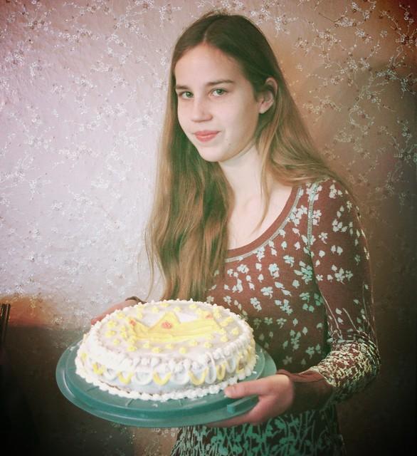 Izzy holding her king cake