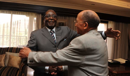 Republic of Zimbabwe President Robert Mugabe with a former African National Congress legal adviser George Chaane of South Africa. Chaane was a schoolmate of President Mugabe. by Pan-African News Wire File Photos