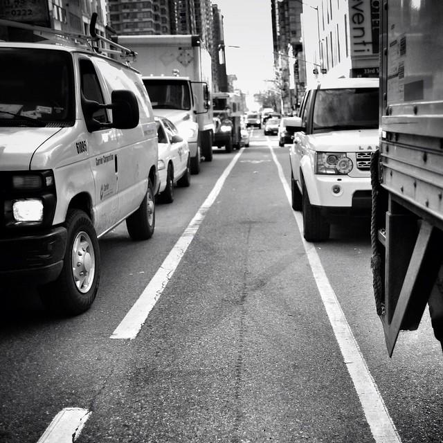 Jammed traffic on the road and sidewalk #walkingtoworktoday