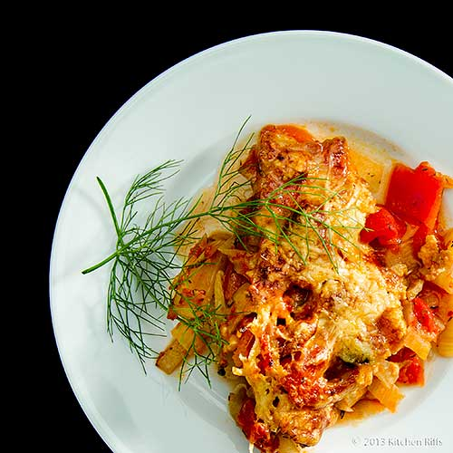 Fennel and Tomato Gratin on plate, overhead view