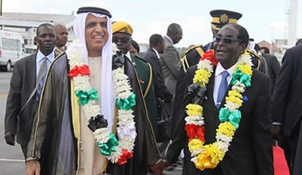 Zimbabwe President Robert Mugabe welcoming Sheikh Saud Bin Saqr Al Qasim of the UAE. He was arriving at Harare International Airport. by Pan-African News Wire File Photos