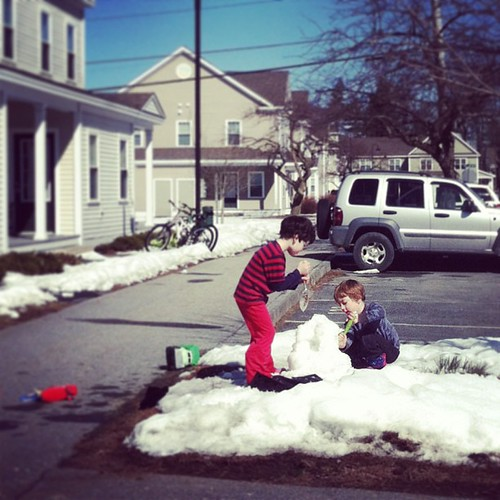 Welcoming spring weather by demolishing a snowman.