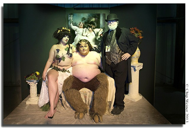 Artist Jinques-right- poses with Santana and Greg Larro his models for the portrait behind them