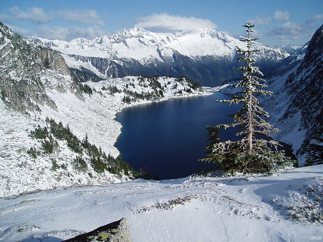 photo of a lake in a snowy valley