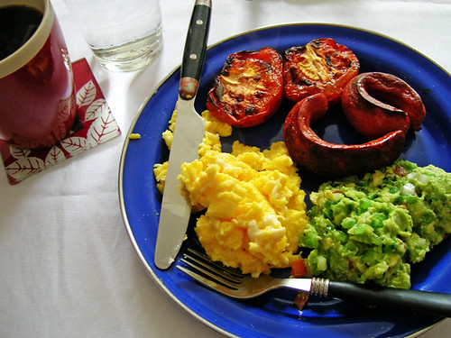 scrambled eggs, broiled tomatoes and hotdogs, and chicago style guacamole