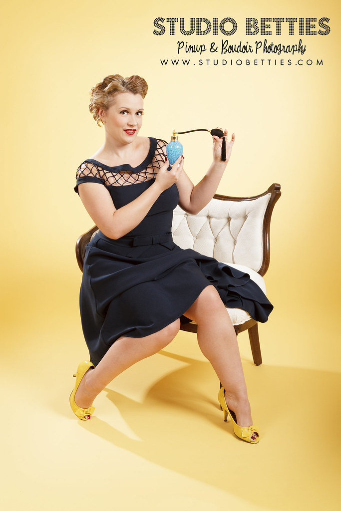 Navy Dress Pinup with Yellow Pumps and Atomizer