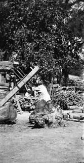 Two men sawing