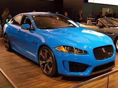 performance car(0.0), sports car(0.0), automobile(1.0), automotive exterior(1.0), wheel(1.0), vehicle(1.0), automotive design(1.0), sports sedan(1.0), auto show(1.0), full-size car(1.0), bumper(1.0), jaguar xf(1.0), sedan(1.0), land vehicle(1.0), luxury vehicle(1.0), supercar(1.0),