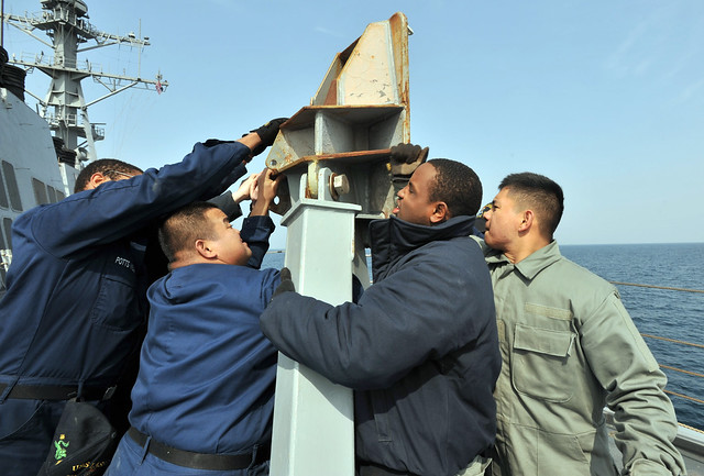 Sailors set up a fueling station aboard USS Lassen