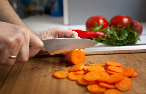 Woman cutting a carrot