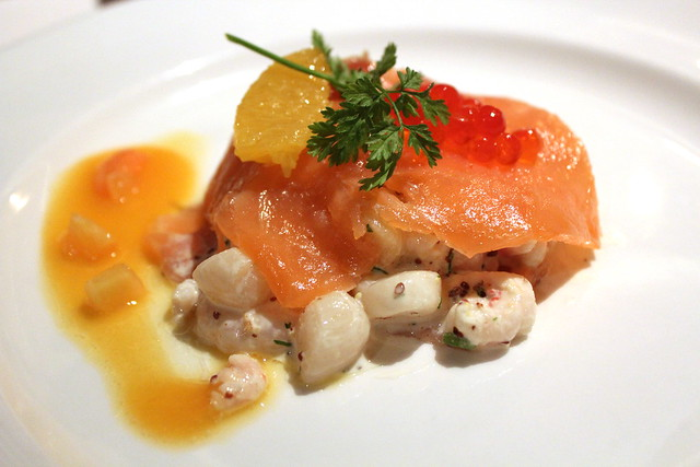 Tian of Premium and Gin-cured Salmon poached sea scallops, shrimp and creamy papaya dressing