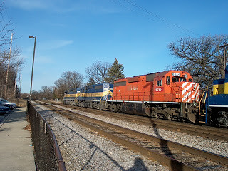Westbound Iowa, Chicago & Eastern freight train passing the River Grove Metra commuter rail station.  River Grove Illinois.  January 2007. by Eddie from Chicago