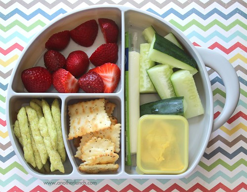 Preschool lunch in a Boon Trunk box - berries, crackers, cucumbers, hummus, snap pea crisps