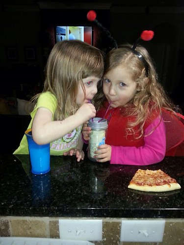 Bria and Chey sharing a cup of milk