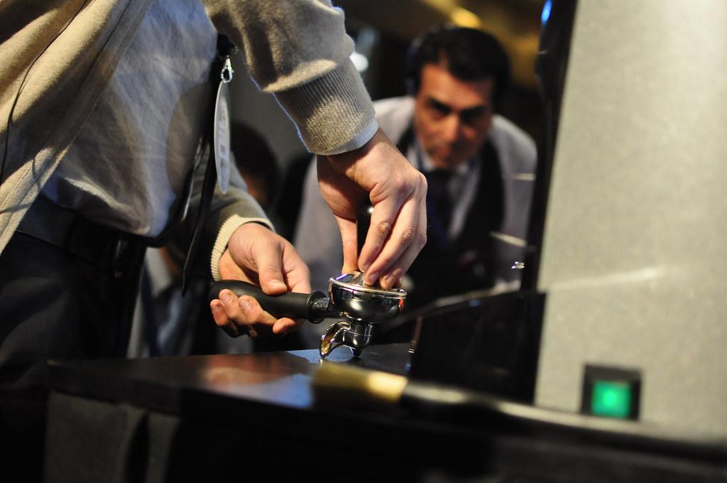 a barista pulling a shot of espresso