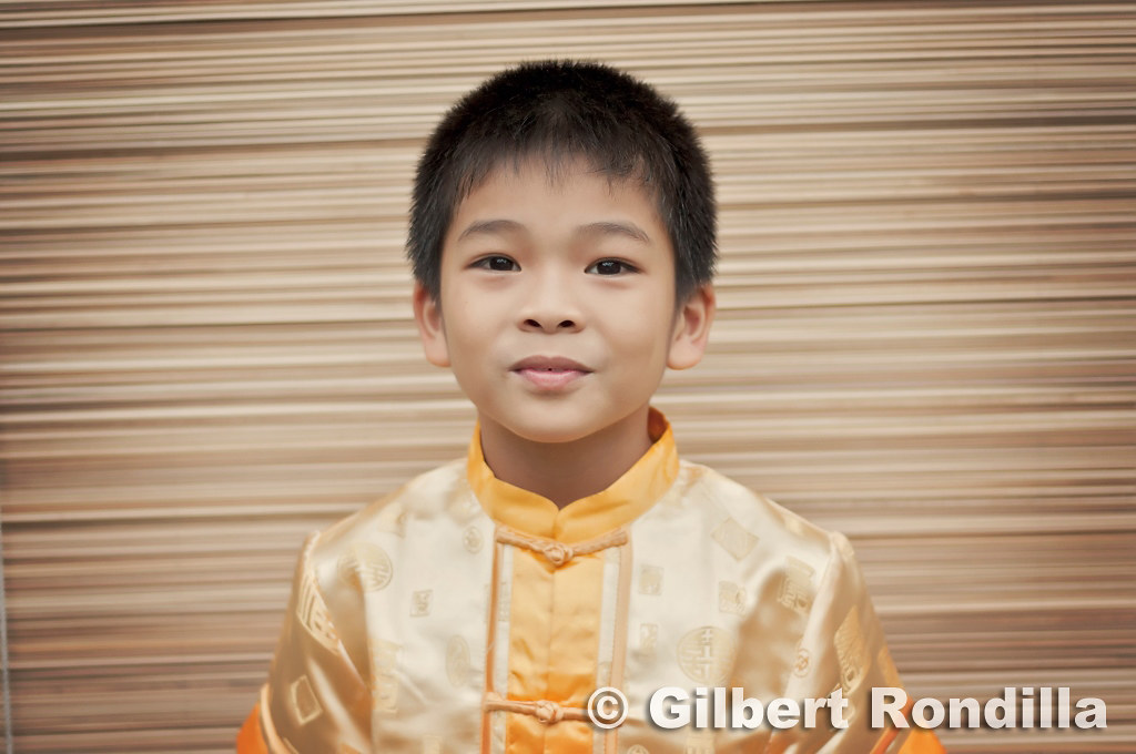 Boy wearing chang pao