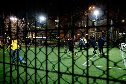 Late night football game in the rain
