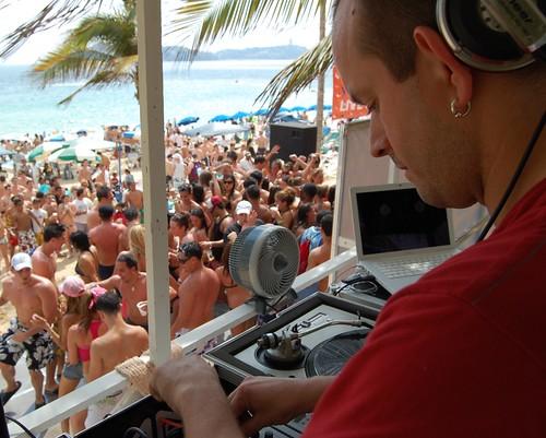 DJ on Spring Break with people dancing below