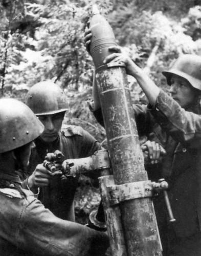 Finnish soldiers  firing a caprured   Soviet  1938 120 mm Mortar  1940