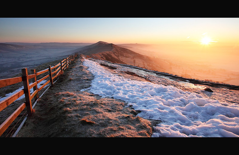 Landscape photo of a winter sunrise on Mam Tor with snow and frost in the Derbyshire Peak District.