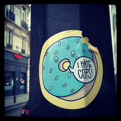 """ i hate cops "" says mr. Doughnut and I totally agree. #doughnuts #streetart #brussels #sticker"