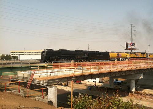 Photo of Union Pacific heritage steam locomotive 844 behind Quebec Street commuter rail bridge