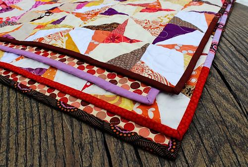 wonky pinwheel quilt scrappy binding