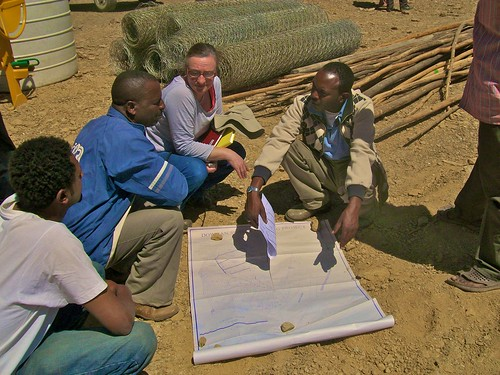 2013 - Ruth Bradfield (architect), Hayish (building contractor in blue), and members of the construction team engage in a site meeting, prior to agreeing the exact location of the convent building
