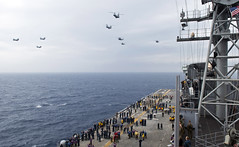 Marine Medium Helicopter Squadron (HMM) 262 flies in formation over USS Bonhomme Richard (LHD 6) during the squadron's debarkation, March 20. (U.S. Navy photo by Mass Communication Specialist 3rd Class Amanda S. Kitchner)
