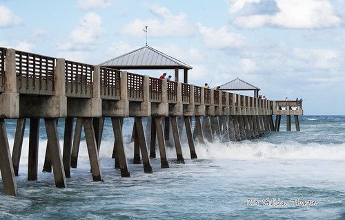 waves under the pier by Alida's Photos