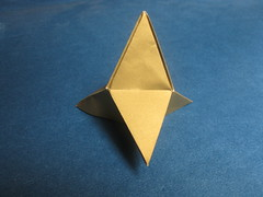wheel(0.0), wing(0.0), triangle(0.0), art(1.0), symmetry(1.0), origami(1.0), triangle(1.0), origami paper(1.0), craft(1.0),