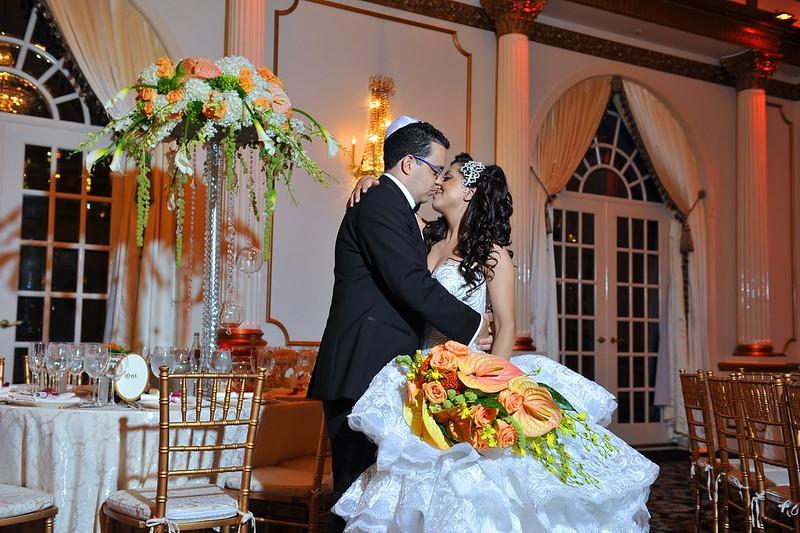 orange bridal bouquet, Crystal Plaza wedding, custom pearl and crystal bridal hair accessory, Swarovski bridal face framer