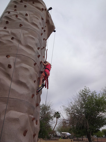 Annie climbing the rock wall