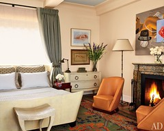 Lovely bedroom: Green accents + orange leather