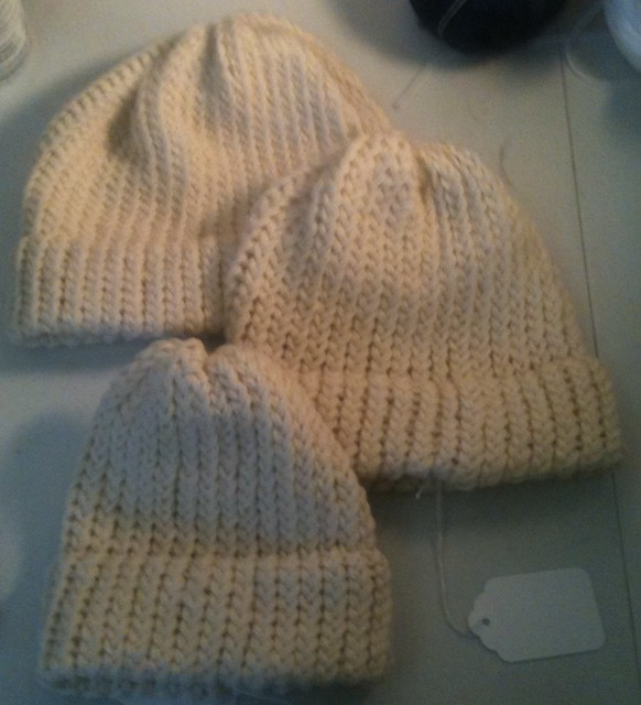 three beige wool hats
