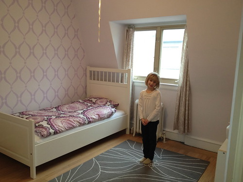 Maja in her insulated, rewired, painted and put-together bedroom
