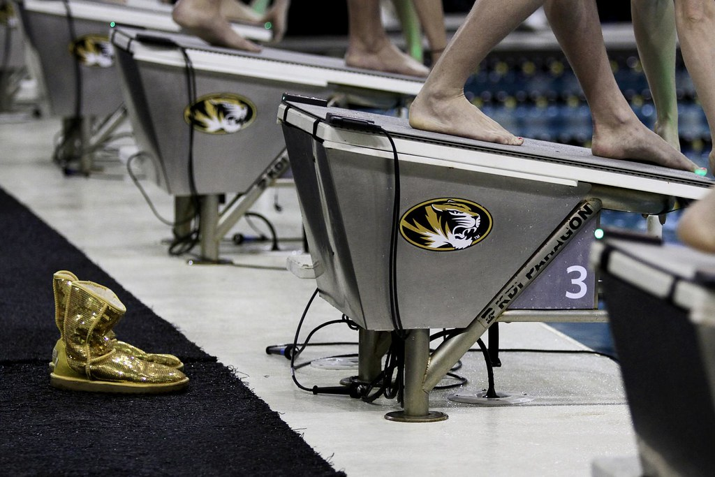 Rachel Ripley's gold sequined Uggs sit behind her starting block before the start of the women's 100 LC meter breaststroke  at the University of Missouri Aquatic Center during the first day of the Missouri Grand Prix on Friday Feb. 10, 2012.  Ripley placed second in her heat behind teammate Amanda Masters by .08 secs with a time of 1:11.14 secs.