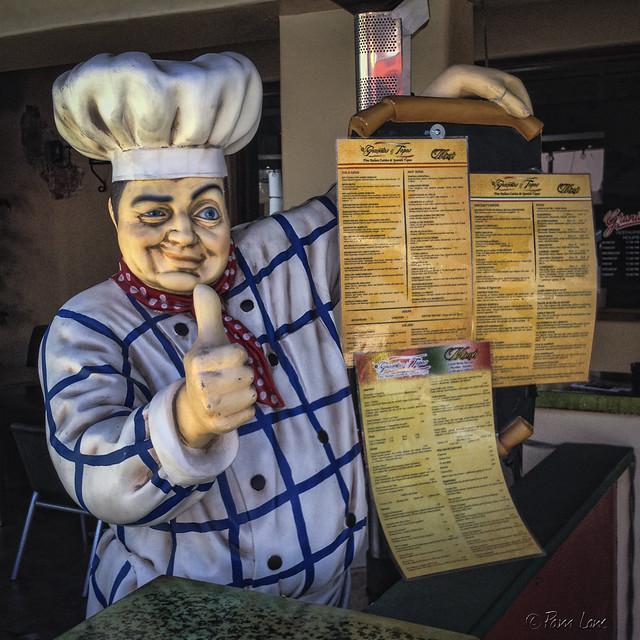 Granata's Tapas waiter statue