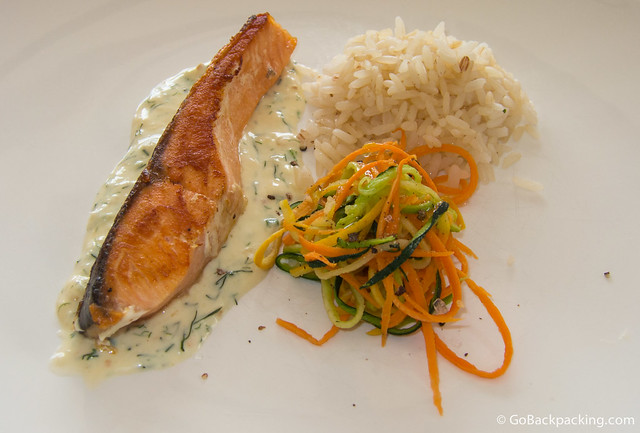 Third course: perfectly cooked salmon with rice and vegetable salad