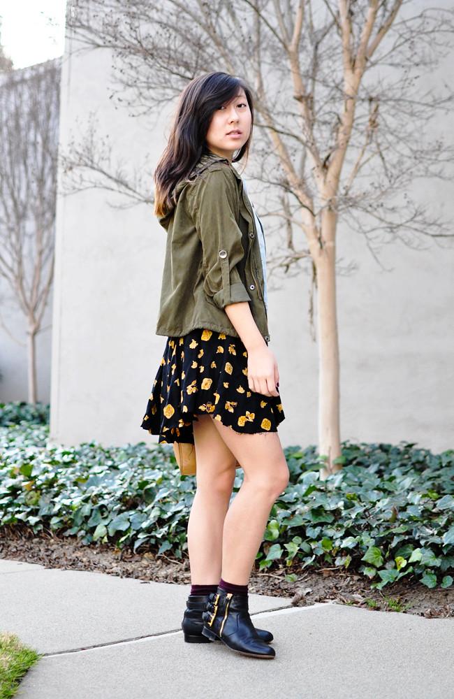 A California-based personal style blog: ModCloth black crop top, vintage printed skirt, H&M denim vest, Brandy Melville army green jacket, maroon H&M ankle socks, Dolce Vita black booties, vintage tan Coach satchel, black braided Levis belt