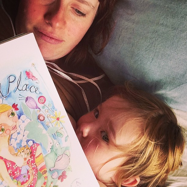Enjoying a snuggle and one of our favorite books #thewonderfulplace #toddlerbreastfeeding @spiralgarden