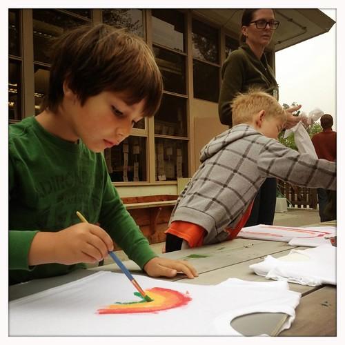 Finn painting his rainbow shirt