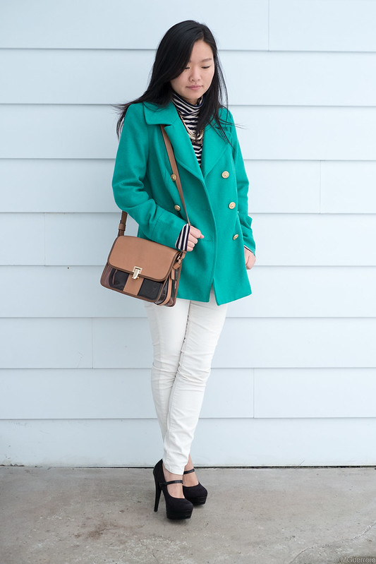 green pea jacket striped shirt white pants brown purse