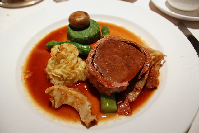 Filet of Beef Tenderloin Wellington with Truffle-Madeira Demi-Glace with spinach flan, glazed carrot and duchesse potatoes