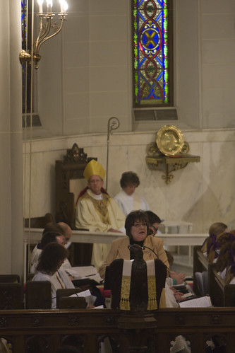 """<p>Bishop Hahn is seated in the <em>cathedra</em>, the ceremonial chair of his office.<br /> (Photos by Michelle Dunlap, <a href=""""http://shellshots.smugmug.com/"""" rel=""""nofollow"""">shellshots.smugmug.com/</a>)</p>"""